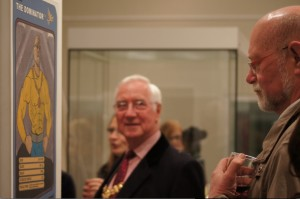 "Ex-Mayor, Dominic Hiscock, contemplating his portrait ""The Dominator"" by satire artist Mark Michael, with current Mayor, Ernie Jeffs, watching on"